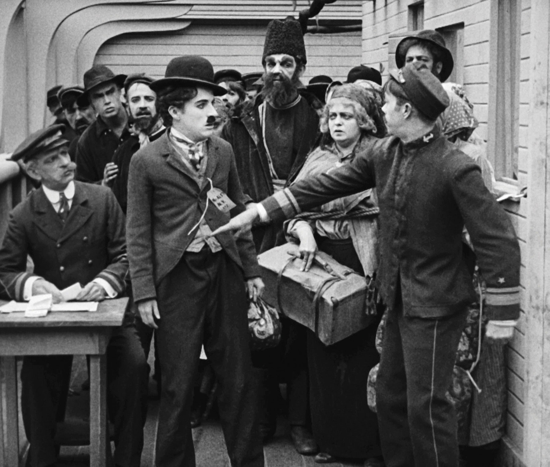 charlie chaplin immigrant essay The tramp, the immigrant, the comedian, the actor, the writer, the musician, the  composer, the director, the husband, the father, the genius.